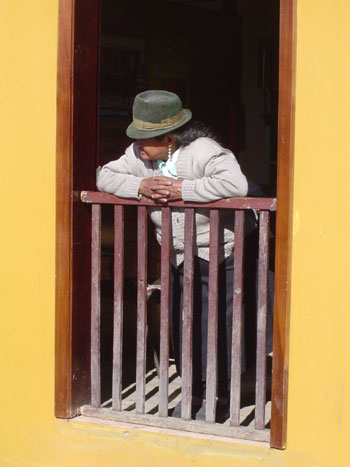 Old lady in ayellow door